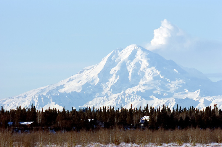 Mount Redoubt emits  steam into the atmosphere about 50 miles across Cook Inlet from the Kenai River's mouth in Kenai, Alaska. The active volcano, one of several on the western side of Cook Inlet, entered an eruptive period in 2009.