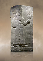 Photo of Hittite relief sculpted orthostat stone panel of Long Wall Basalt, Karkamıs, (Kargamıs), Carchemish (Karkemish), 900-700 B.C. Anatolian Civilizations Museum, Ankara, Turkey.<br /> <br /> Goddess Kubaba. Goddess is depicted from the profile. The part below the chest of the relief is broken. She holds a pomegranate in her hands on her chest. She carries a one-horned headdress on her head. Her braided hair hangs down to her shoulder. The text in the hieroglyphics is not understood. The lower part of the relief has been restored. <br /> <br /> On a brown art background.