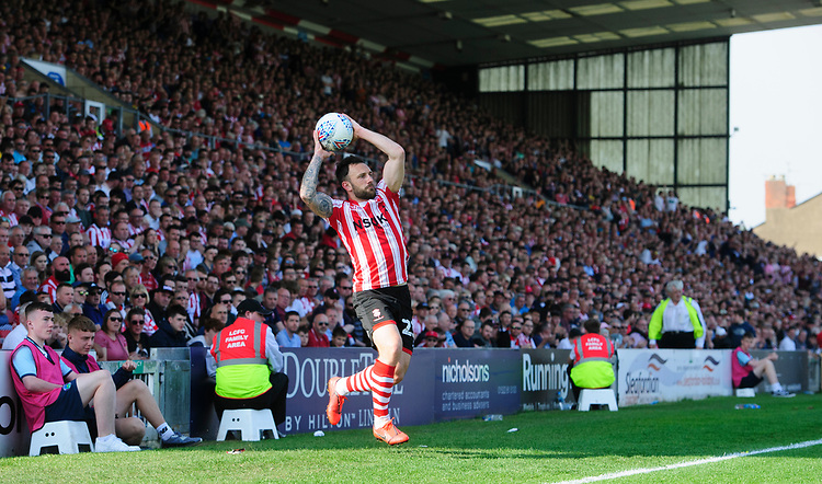 Lincoln City's Neal Eardley<br /> <br /> Photographer Chris Vaughan/CameraSport<br /> <br /> The EFL Sky Bet League Two - Lincoln City v Tranmere Rovers - Monday 22nd April 2019 - Sincil Bank - Lincoln<br /> <br /> World Copyright © 2019 CameraSport. All rights reserved. 43 Linden Ave. Countesthorpe. Leicester. England. LE8 5PG - Tel: +44 (0) 116 277 4147 - admin@camerasport.com - www.camerasport.com