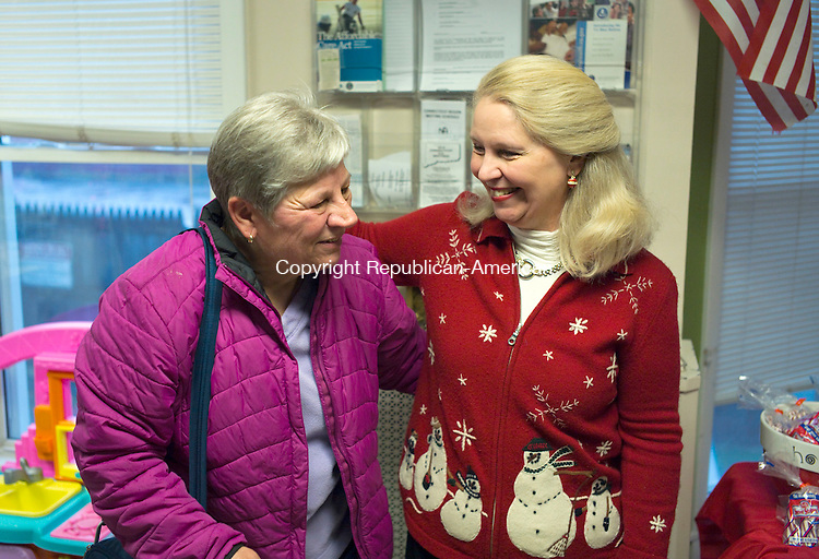 TORRINGTON, CT- 22 December 2015-122215CM03- Deirdre DiCara, right, Executive Director at FISH (Friends in Service to Humanity) greets Mary Jane Mazzarelli of Torrington on Tuesday.  FISH held a Christmas party which featured an accordion player, cookies and Santa for the families and children who live there.  Christopher Massa Republican-American
