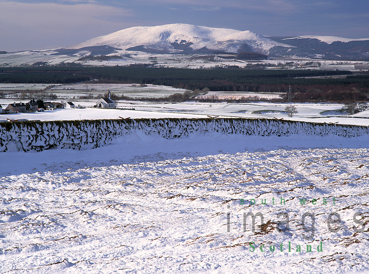 Winter landscape Scotland snow looking down on Mouswald Church and across Nithsdale to the solid lump of Criffel Dumfries and Galloway UK
