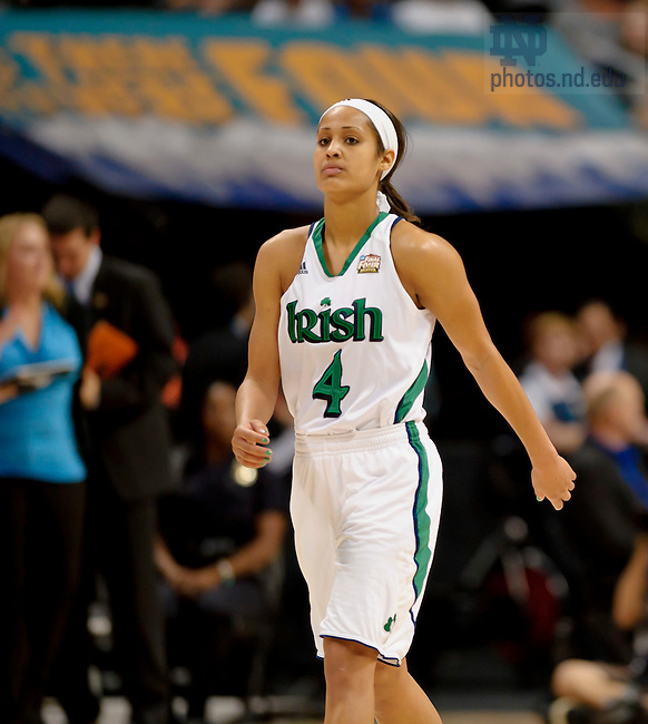 Apr. 1, 2012; Skylar Diggins walks to the bench in the first half against UConn in the Women's Final Four at the Pepsi Center in Denver, CO...Photo by Matt Cashore/University of Notre Dame