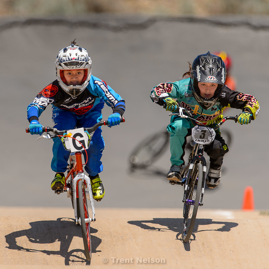 Trent Nelson  |  The Salt Lake Tribune<br /> 9-year-old girls Gianna Davila, left, and Stella Sunseri race at the U.S. BMX National Series at Rad Canyon BMX in South Jordan, Saturday June 13, 2015.