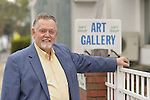 Port Washington, New York, U.S 6th October 2013.  WALTER KEHOE at the entrance toThe Artists Reception for Members Showcase of the Art Guild of Port Washington, at The Graphic Eye Gallery.