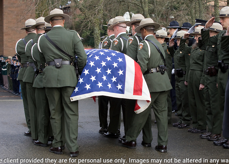 National Park Service Pallbearers carry the casket of National Park Service Ranger Margaret Anderson during a memorial service at the Pacific Lutheran University in Tacoma on January 10, 2010. Anderson, was slain at Mount Rainier on New Years' Day when she set up a road block to intercept a vehicle, driven by Benjamin Barnes, who failed to stop at a chain-up checkpoint.  Barnes, the suspect  in the shooting was found dead was found dead the next day. He had drown in Paradise Creek.     ©2012. Jim Bryant Photo. All RIGHTS RESERVED.