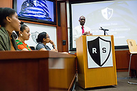 """New York Assemblyman (79th District) and Vice Chair of the Democratic National Committee Michael Blake speaks to a live audience during a session of Resistance School in the Starr Auditorium in the Belfer Building of Harvard University's John F. Kennedy School of Government, on Thurs., April 27, 2017. Blake's lecture was titled """"How to sustain the resistance long term."""" The lecture, which was the fourth such session and the final in what the group calls the """"first semester"""" of Resistance School, was also streamed live on the internet. Resistance School was started by progressive graduate students at Harvard after the Nov. 8, 2016, election of President Donald Trump. Resistance School describes itself as a """"practical training program that will sharpen the tools [needed] to fight back at the federal, state, and local levels."""" The live lectures are streamed and archived online alongside other information on the Resistance School website. During the lectures, teams of volunteers engage with followers on social media, including Facebook and twitter, sharing soundbytes, quotations, and supplementary materials as the lectures happen."""
