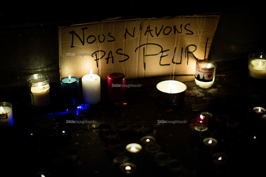 """Paris, France, 15.11.2015. A piece of a cardboard box with a message saying """"we are not arfaid"""" lies at the Place de la Republique. Images from Paris in the aftermath of the devastating terror attacks on friday november 13. Photo: Christopher Olssøn."""