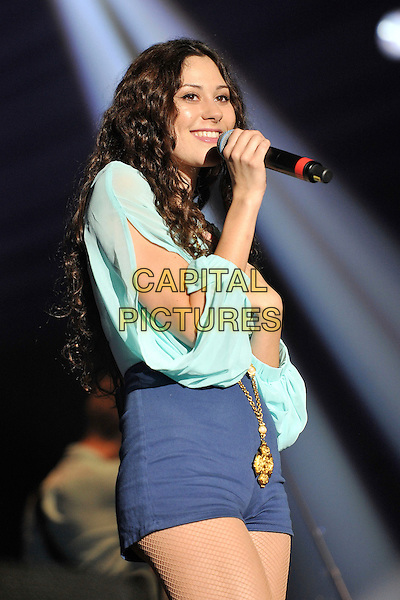 Eliza Doolittle .Performing live at the 'Girlguiding UK  Big Gig' at Wembley Arena, London, UK, 1st October 2011..music concert  live on stage half length turquoise top long sleeves microphone singing hotpants blue shorts  gold necklace .CAP/MAR.© Martin Harris/Capital Pictures.