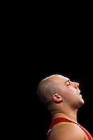 11 DEC 2011 - LONDON, GBR - Bartlomiej Bonk (POL) prepares to lift during the men's +105kg category Snatch during the London International Weightlifting Invitational and 2012 Olympic Games test event held at the ExCel Exhibition Centre in London, Great Britain .(PHOTO (C) NIGEL FARROW)
