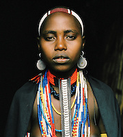 Portrait of Hamer tribeswoman wearing headgear in Turmi, Lower Omo Valley, Ethiopia