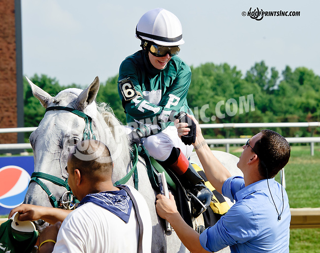 Wealth to Me winning at Delaware Park racetrack on 7/2/14<br /> trainer Dane Kobiskie congratulating jockey Cecily Evans