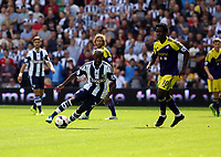 Pictured L-R: Billy Jones of West Brom swings past Wilfried Bony of Swansea. Sunday 01 September 2013<br />