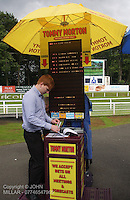 Tommy Morton Bookmaker preparing for the night ahead at the Racenight with Reggie Yates Meeting at Hamilton Park Racecourse on 14.7.12.