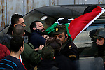 Palestinian policemen push away protesters from the convoy of Jerusalem's Greek Orthodox patriarch Theophilos III in the West Bank town of Bethlehem on January 6, 2018 ahead of a Christmas service according to the Eastern Orthodox calendar. The municipalities of Bethlehem, Beit Sahour and Beit Jala, all in the Israeli-occupied West Bank, called for the boycott over Jerusalem's Greek Orthodox patriarch allegedly allowing controversial real estate sales. Photo by Wisam Hashlamoun