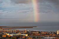 A partial rainbow appears over Swansea Marina in south Wales, UK. Monday 09 September 2019