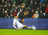 2nd January 2020; Liberty Stadium, Swansea, Glamorgan, Wales; English Football League Championship, Swansea City versus Charlton Athletic; Lyle Taylor of Charlton Athleic is tackled by Ben Cabango of Swansea City - Strictly Editorial Use Only. No use with unauthorized audio, video, data, fixture lists, club/league logos or 'live' services. Online in-match use limited to 120 images, no video emulation. No use in betting, games or single club/league/player publications
