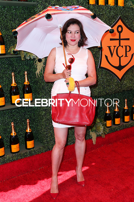 PACIFIC PALISADES, CA, USA - OCTOBER 11: Jennifer Tilly arrives at the 5th Annual Veuve Clicquot Polo Classic held at Will Rogers State Historic Park on October 11, 2014 in Pacific Palisades, California, United States. (Photo by Xavier Collin/Celebrity Monitor)