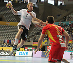 20.01.2013 Barcelona, Spain. IHF men's world championship, eighth.final. Picture show Stefan Kneer in action during game between Germany  vs FYRO Macedonia at Palau st Jordi