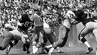 Raiders vs. 49ers....John Brodie passing Ben Davidson, Cas Banaszek blocking Ike Lassiter..(1969 photo/Ron Riesterer)