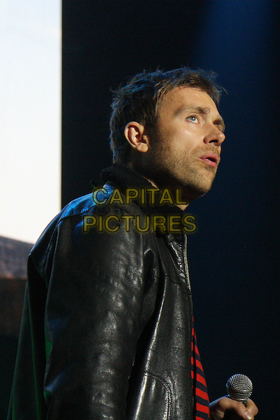 GORILLAZ - DAMON ALBARN.Performing live at The Roundhouse, London, England..April 29th, 2010.stage concert live gig performance music half length black leather jacket red top striped stripes .CAP/MAR.© Martin Harris/Capital Pictures.