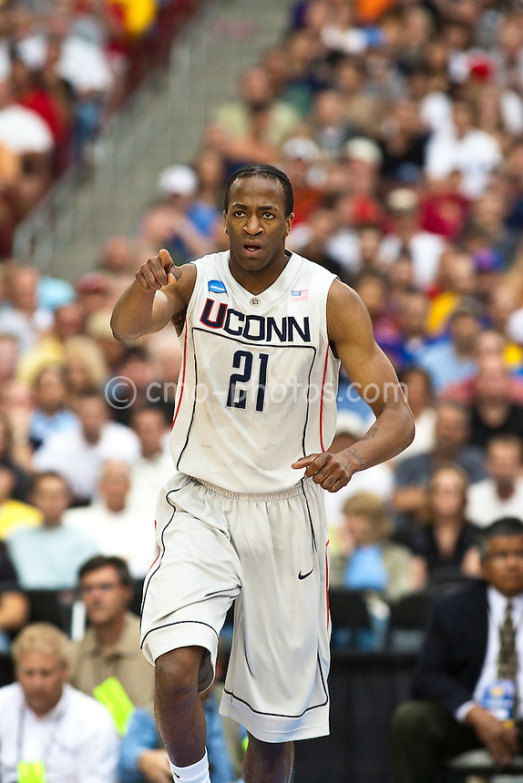 Mar 28, 2009; Glendale, AZ, USA; Connecticut Huskies forward Stanley Robinson (21) reacts to making a basket in the first half of a game against the Missouri Tigers in the finals of the west region of the 2009 NCAA basketball tournament at University of Phoenix Stadium.