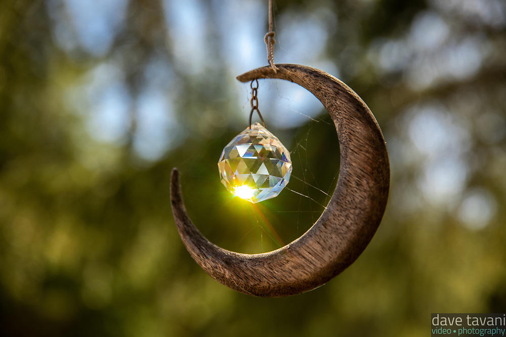 A tiny crescent moon and crystal ball catch the light outside of our airbnb in Sebastopol.