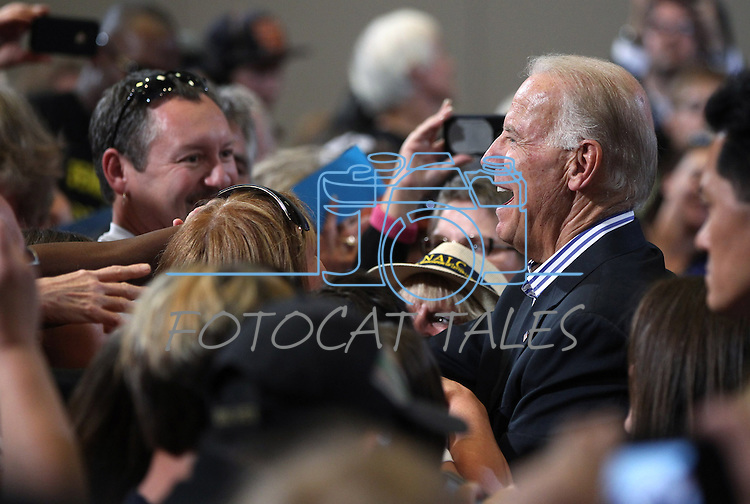 Vice President Joe Biden greets the crowd following a campaign stop in Reno, Nev., on Wednesday, Oct. 17, 2012. (AP Photo/Cathleen Allison)