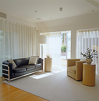 The bedroom has a comfortable seating area that opens onto the roof terrace