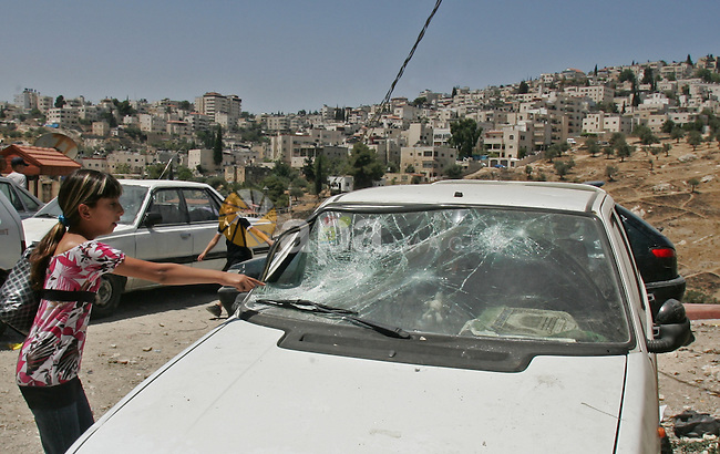 Palestinians inspect the damage in cars by Israeli soldiers after clashes with Palestinian protesters in the Arab east Jerusalem neighbourhood of Silwan on June 28, 2010. Photo by Mahfouz Abu Turk