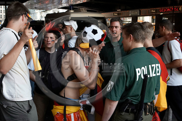 "BERLIN - GERMANY 20. JUNE 2006 -- FIFA World Cup 2006 - Germany - Ecuador 3-0 - German football fans having a bash at Friedrichsstrasse after the match gets calmed down by the police -- PHOTO: CHRISTIAN T. JOERGENSEN /  EUP & IMAGES..This image is delivered according to terms set out in ""Terms - Prices & Terms"". (Please see www.eup-images.com for more details)"