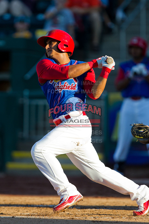 Donovan Solano (11) of the Springfield Cardinals follows through his swing during a game against the Corpus Christi Hooks at Hammons Field on August 13, 2011 in Springfield, Missouri. Springfield defeated Corpus Christi 8-7.  (David Welker / Four Seam Images)
