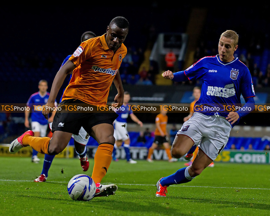 Razak Boukari, Wolverhampton Wanderers FC tries to lay the ball off under pressure from Lee Martin, Ipswich Town FC - Ipswich Town vs Wolverhampton Wanderers - NPower Championship Football at Portman Road, Ipswich, Suffolk - 19/09/12 - MANDATORY CREDIT: Ray Lawrence/TGSPHOTO - Self billing applies where appropriate - 0845 094 6026 - contact@tgsphoto.co.uk - NO UNPAID USE.