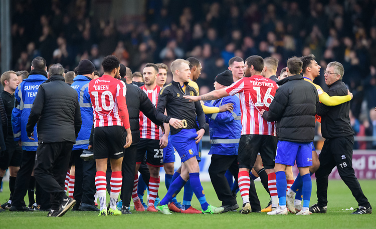 Tempers threaten to boil over at the end of the game<br /> <br /> Photographer Chris Vaughan/CameraSport<br /> <br /> The EFL Sky Bet League Two - Lincoln City v Mansfield Town - Saturday 24th November 2018 - Sincil Bank - Lincoln<br /> <br /> World Copyright © 2018 CameraSport. All rights reserved. 43 Linden Ave. Countesthorpe. Leicester. England. LE8 5PG - Tel: +44 (0) 116 277 4147 - admin@camerasport.com - www.camerasport.com