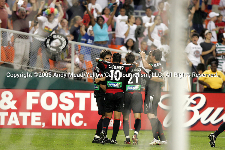 17 September 2005: Jaime Moreno (l) is mobbed in celebration by teammates Christian Gomez (10), Dema Kovalenko (21), and Santino Quaranta (r) after his 80th minute goal. DC United defeated the Colorado Rapids 2-0 at RFK Stadium in Washington, DC in a regular season Major League Soccer game. .