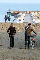 Passeggiata in bicicletta sulla spiaggia del Lido di Venezia.<br /> Cyclists on the beach at Venice's Lido.<br /> UPDATE IMAGES PRESS/Riccardo De Luca