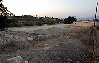 Pictured: Mounts of rubble and soil left at the farmhouse (R) site where Ben Needham disappeared from in Kos, Greece. <br />Re: The search for missing Ben Needham led by South Yorkshire Police has concluded on the Greek island of Kos.<br />Ben, from Sheffield, was 21 months old when he disappeared on 24 July 1991 during a family holiday.<br />Digging took place around the farmhouse where Ben Needham was last seen and at a new site after a fresh line of inquiry suggested he could have been crushed by a digger.