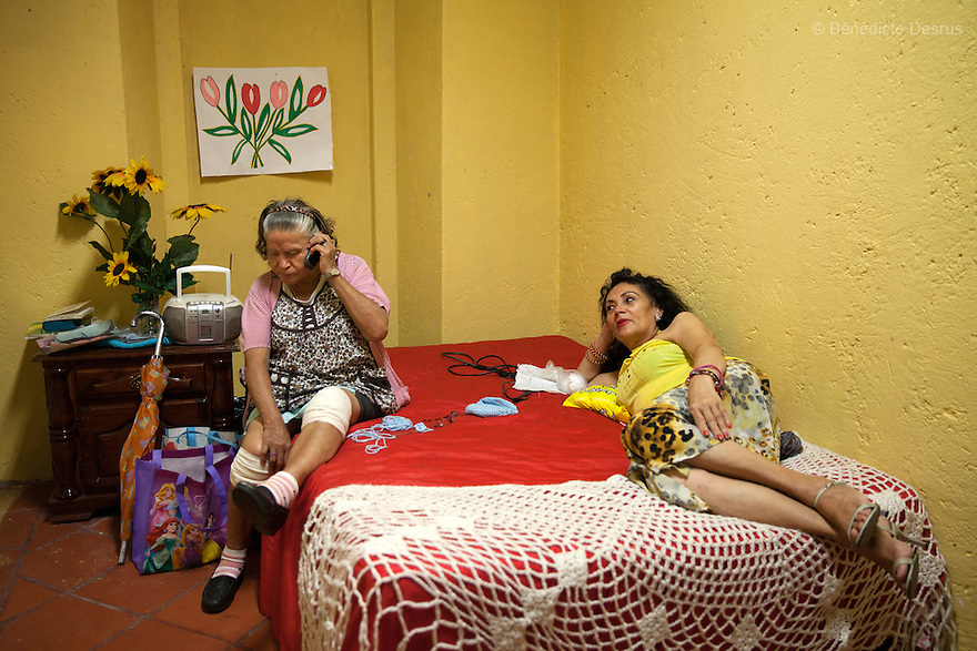 Margarita (L) and Norma Angekica (R), both residents of Casa Xochiquetzal, at the shelter in Mexico City, Mexico on July 1, 2013. Casa Xochiquetzal is a shelter for elderly sex workers in Mexico City. It gives the women refuge, food, health services, a space to learn about their human rights and courses to help them rediscover their self-confidence and deal with traumatic aspects of their lives. Casa Xochiquetzal provides a space to age with dignity for a group of vulnerable women who are often invisible to society at large. It is the only such shelter existing in Latin America. Photo by Bénédicte Desrus