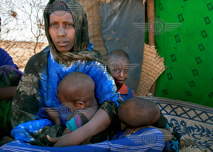 Khadra Yusef Saeed, a pastoralist whose livestock has been steadily dying as a result of a region-wide drought, has now lost her youngest child who died aged one week, unable to get sufficient nutrition from Khadra's milk. The drought has brought Somaliland to the brink of famine and if April's rains fail the region faces disaster.