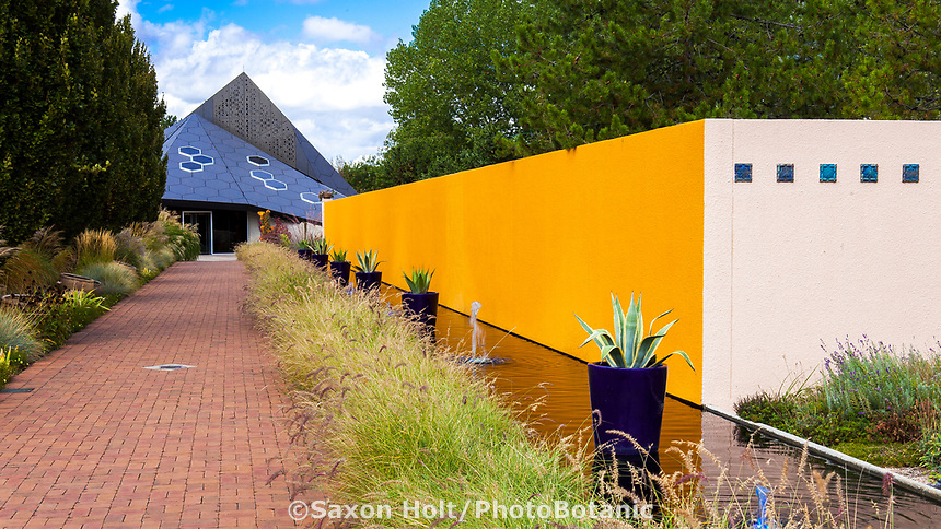 El Pomar Waterway and brick path lined with Pennisetum grass leading to Science Pyramid in Denver Botanic Garden