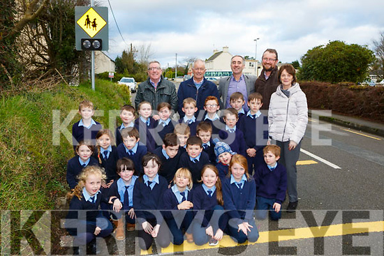 Principal Margaret Hanafin, John O'Connor Parents Association, Cllr Bobby O'Connell, Cllr John Joe Culloty and Cllr Brendan Cronin and pupils from Currow who have welcomed the traffic calming lights installed outside their school
