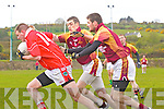 Gary Savage of St Pat's Blennerville feels the pressure from Duagh's John Sheeran and Peter Sheeran last Sunday afternoon in Duagh.