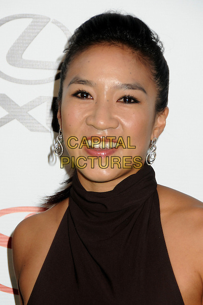 Michelle Kwan.2011 Environmental Media Awards held at Warner Bros. Studios, Burbank, California, USA, 15th October 2011 .portrait headshot  smiling brown polo high neck .CAP/ADM/BP.©Byron Purvis/AdMedia/Capital Pictures.