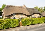 Historic thatched cottages at village of Sandy Lane, Wiltshire, England, UK