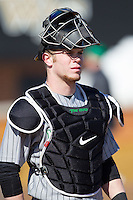 Travis Wildermuth (20) of the Marshall Thundering Herd watches from the bullpen during the NCAA baseball game against the Georgetown Hoyas at Wake Forest Baseball Park on February 15, 2014 in Winston-Salem, North Carolina.  The Thundering Herd defeated the Hoyas 5-1.  (Brian Westerholt/Four Seam Images)