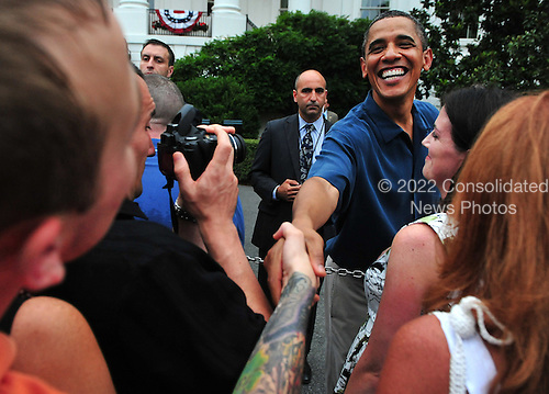 United States President Barack Obama greets members of the crowd as he welcomes members of the White House staff and armed servicemen and women at an Independence Day barbeque on the South Lawn of the White House in Washington on Monday, July 4, 2011. .Credit: Kevin Dietsch / Pool via CNP