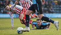 Garry Thompson of Wycombe Wanderers & Lee Cox of Stevenage watch the ball during the Sky Bet League 2 match between Wycombe Wanderers and Stevenage at Adams Park, High Wycombe, England on 12 March 2016. Photo by Andy Rowland/PRiME Media Images.