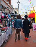 ENGLAND, Brighton, Couple Walking on North Lane