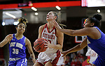 VERMILLION, SD: JANUARY 13:  Jaycee Bradley #12 of South Dakota drives between Ft. Wayne defenders Diamond Williams #30 and KeShyra McCarver #3 during their Summit League game Saturday January 13 at the Sanford Coyote Sports Center in Vermillion, S.D.   (Photo by Dick Carlson/Inertia)