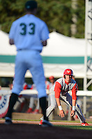 Williamsport Crosscutters outfielder Justin Parr #15 leads off first as Cody Dickson #33 gets ready to deliver a pitch during a game against the Jamestown Jammers on June 20, 2013 at Russell Diethrick Park in Jamestown, New York.  Jamestown defeated Williamsport 12-6.  (Mike Janes/Four Seam Images)