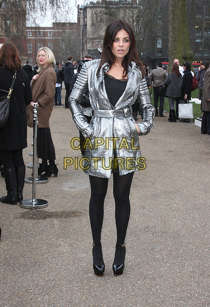 JULIA RESTOIN-ROITFELD.The Burberry Prorsum Fashion Show during London Fashion Week Autumn/Winter 2011, Kensington Gardens, London, England..21st February 2011.LFW full length black silver jacket leather snakeskin scales black tights shoes hands in pockets .CAP/ROS.©Steve Ross/Capital Pictures